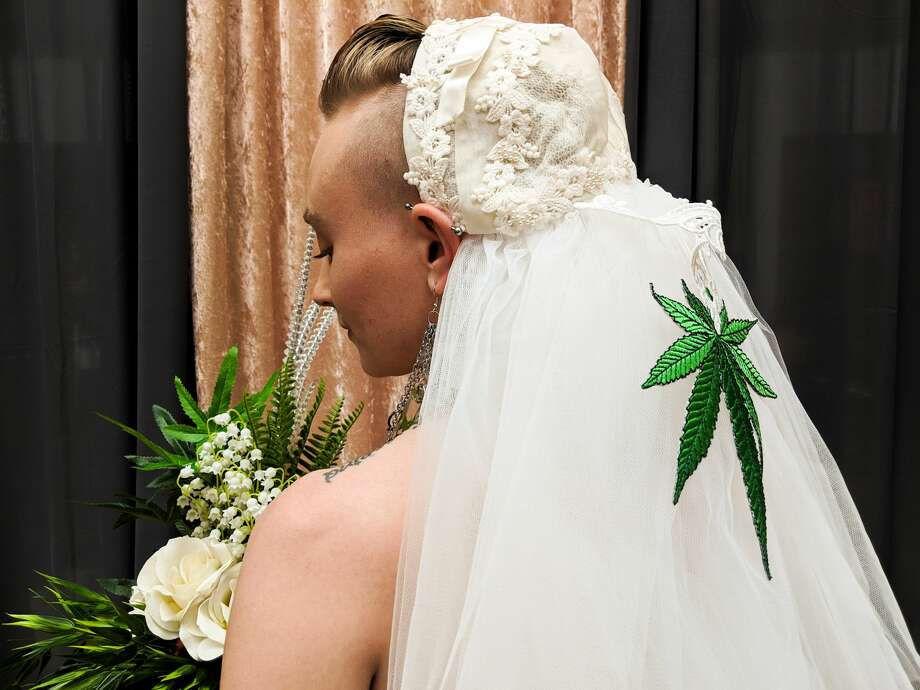 A cannabis artist who goes by the name Green Tiger Lilly poses for a photo while wearing a bouquet and wearing a veil at the Cannabis Wedding Expo at Westfield Mall in San Francisco on Sunday, Feb. 17, 2019. Photo: Drew Costley/SFGATE