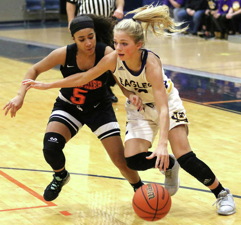 CM freshman Kelbie Zupan (right) drives on Springfield Lanphier's Tionna Traylor during Thursday's championship game at the Rochester Class 3A Regional. CM won and takes a 28-5 record to Monday's Taylorville Sectional. Photo: Greg Shashack / The Telegraph