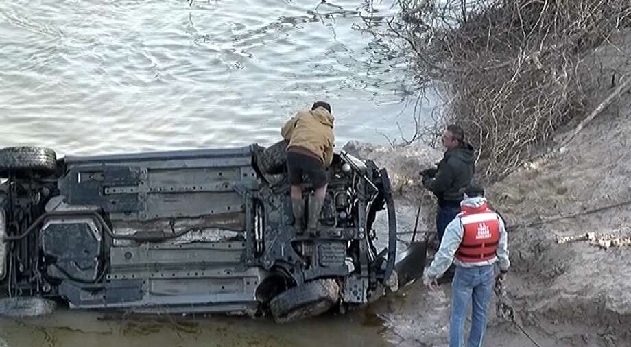 Body, car found submerged in Trinity River during search for missing woman Photo: Scott Engle