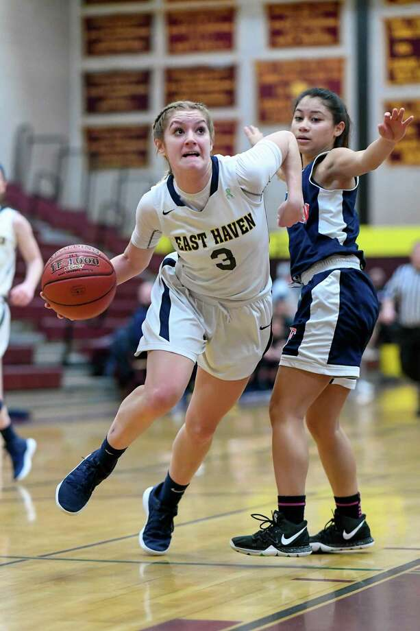 East Haven senior guard Makenzie Helms drives against Foran in an SCC girls basketball tournament quarterfinal game on Saturday. Photo: David G. Whitham /For Hearst Connecticut Media / DGWPhotography