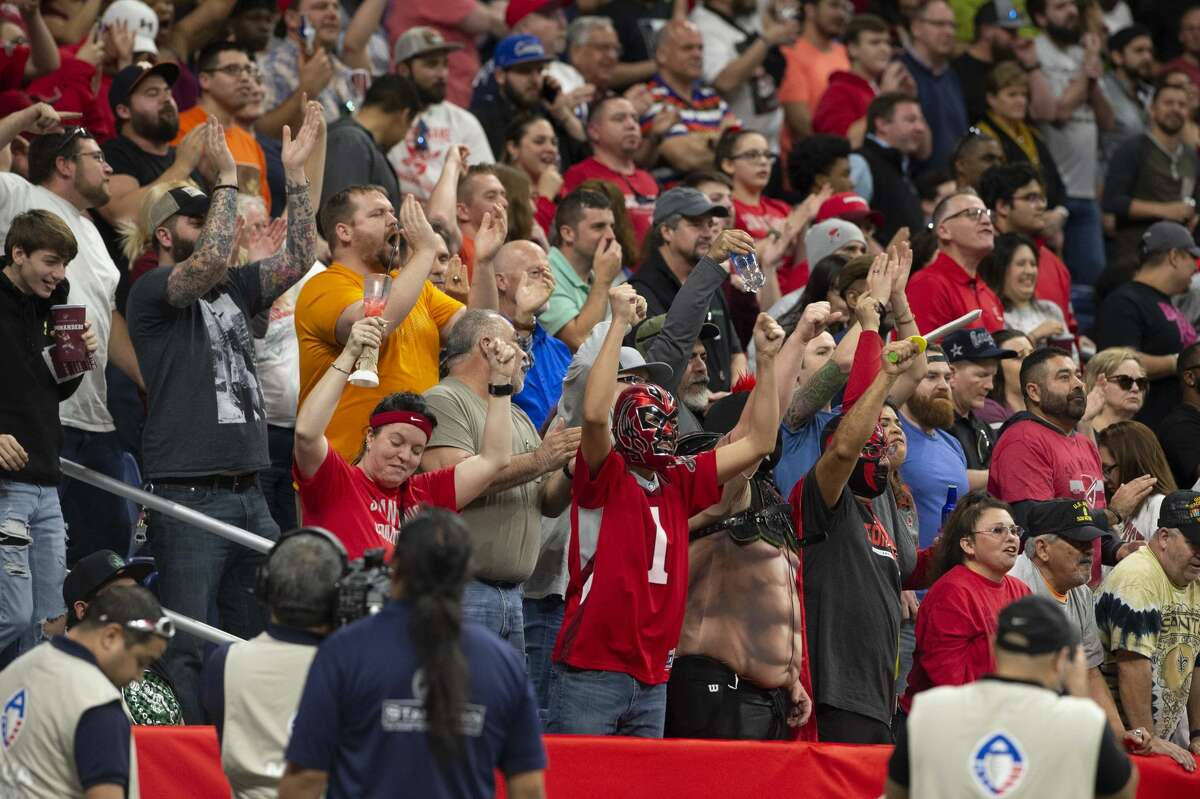 San Antonio Commanders fans celebrate with fans after the ball was striped away by Joey Mbu from Apollos quarterback Garrett Gilbert during the second half of play on Sunday, February 17, 2019.