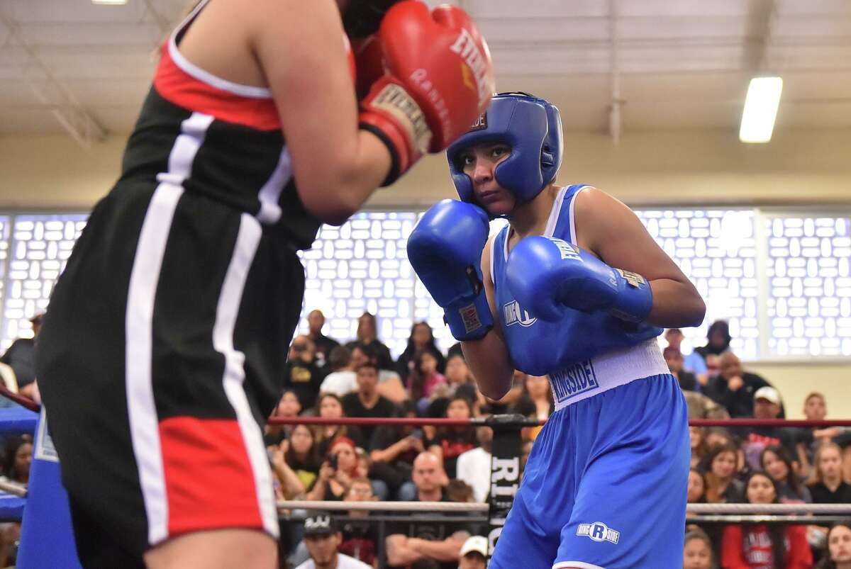 Devany Cuevas lines up her opponent, Samantha Munguia during the 2019 San Antonio Regional Golden Gloves tournament Sunday at the Lincoln Community Center.