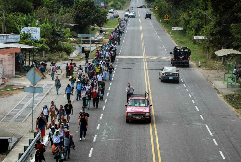 """Central American migrants walk along the Suchiate-Tapachula road in the municipality of Tapachula, Chiapas State, Mexico, on February 17, 2019. - President Donald Trump, repeating his claim that """"walls work,"""" announced Friday that he will declare a national emergency in order to build a barrier on the US-Mexico border without funding from Congress. (Photo by BENJAMIN ALFARO / AFP)BENJAMIN ALFARO/AFP/Getty Images Photo: BENJAMIN ALFARO / AFP or licensors"""