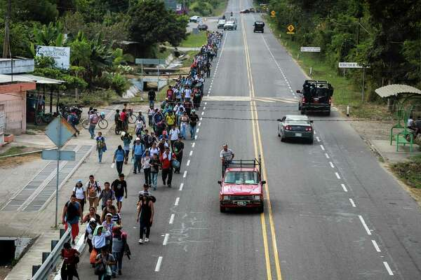 "Central American migrants walk along the Suchiate-Tapachula road in the municipality of Tapachula, Chiapas State, Mexico, on February 17, 2019. - President Donald Trump, repeating his claim that ""walls work,"" announced Friday that he will declare a national emergency in order to build a barrier on the US-Mexico border without funding from Congress. (Photo by BENJAMIN ALFARO / AFP)BENJAMIN ALFARO/AFP/Getty Images"