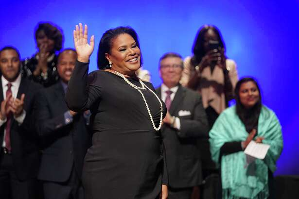 Yolanda Ford, mayor of Missouri City, waves as she enters on stage for her inauguration ceremony held at Thurgood Marshall High School Sunday, Feb. 17, 2019. She is the first woman and African American ever elected for the city's highest office.