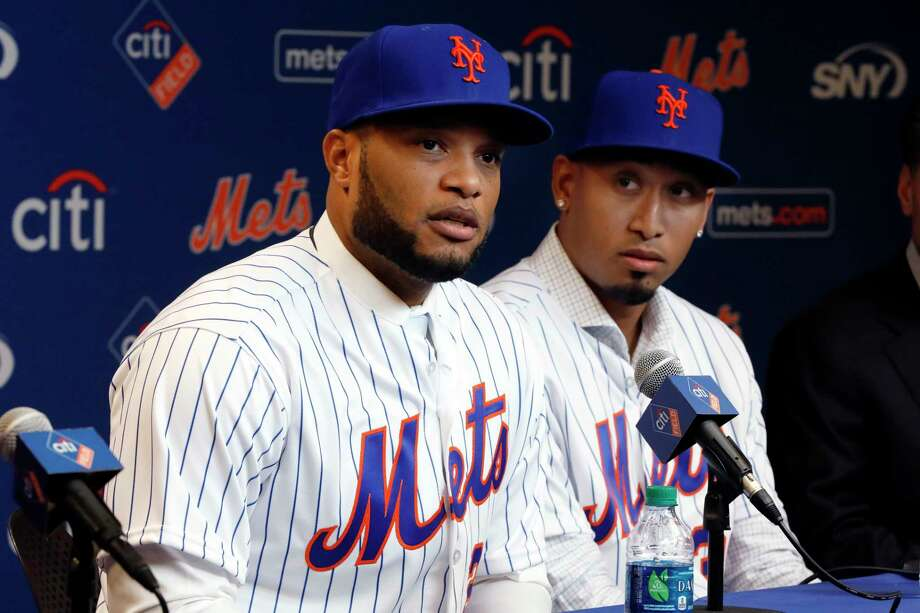 FILE - In this Dec. 4, 2018, file photo, Robinson Cano, left, and Edwin Diaz participate in a news conference at CitiField, in New York. In a flurry of offseason moves that began with a blockbuster trade with Seattle, the Mets added second baseman Cano, closer Diaz, catcher Wilson Ramos and infielder Jed Lowrie. (AP Photo/Richard Drew, File) Photo: Richard Drew / Copyright 2018 The Associated Press. All rights reserved