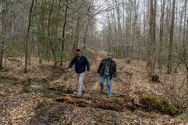 James Morelli and Edwin Moses of Origis Energy walk through Charles County, Maryland, land on Feb. 14, 2019.