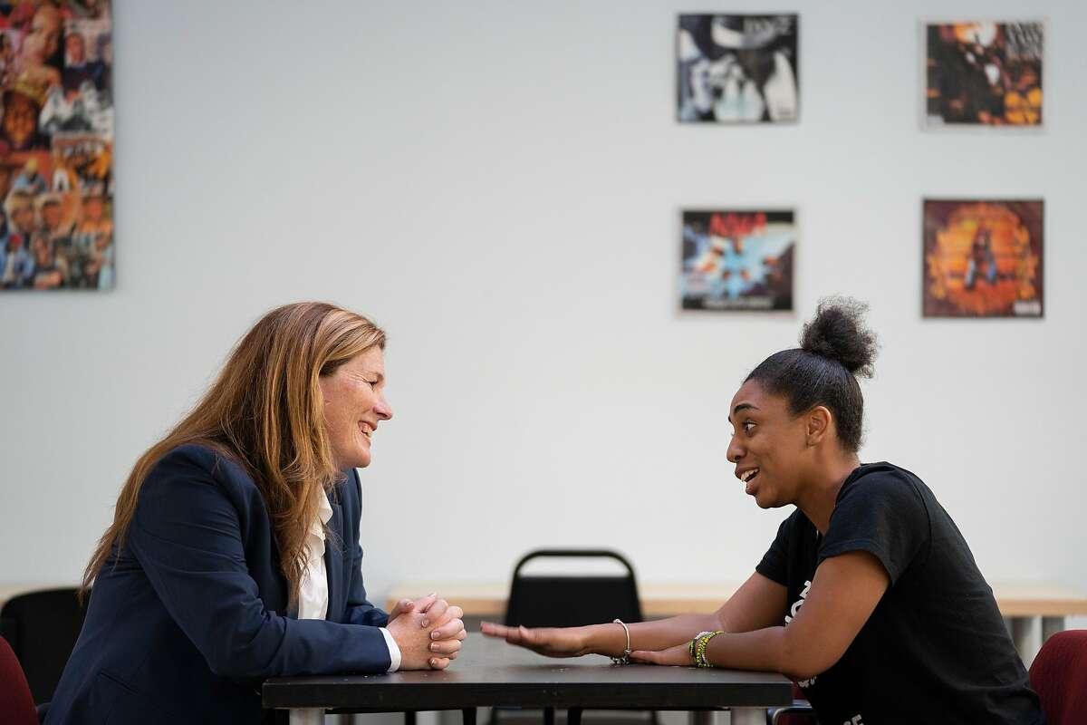 From left: Suzy Loftus mentors Morgan Tucker during the Community Safety Initiative program at the Ella Hill Hutch Community Center, Friday, Sept. 14, 2018, in San Francisco, Calif.