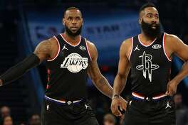 CHARLOTTE, NORTH CAROLINA - FEBRUARY 17: LeBron James #23 of the LA Lakers and James Harden #13 of the Houston Rockets both of Team LeBron look on as they play against Team Giannis in the first quarter during the NBA All-Star game as part of the 2019 NBA All-Star Weekend at Spectrum Center on February 17, 2019 in Charlotte, North Carolina. NOTE TO USER: User expressly acknowledges and agrees that, by downloading and/or using this photograph, user is consenting to the terms and conditions of the Getty Images License Agreement. Mandatory Copyright Notice: Copyright 2019 NBAE (Photo by Streeter Lecka/Getty Images)