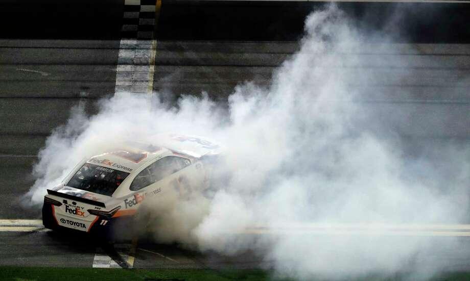 Denny Hamlin does a burnout after winning a NASCAR Daytona 500 auto race Sunday, Feb. 17, 2019, at Daytona International Speedway in Daytona Beach, Fla. (AP Photo/Chris O'Meara) Photo: Chris O'Meara / Copyright 2019 The Associated Press. All rights reserved.