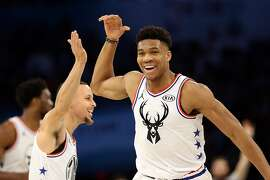 CHARLOTTE, NORTH CAROLINA - FEBRUARY 17:  Giannis Antetokounmpo #34 of the Milwaukee Bucks and Team Giannis celebrates with Stephen Curry #30 of the Golden State Warriors against Team LeBron in the second quarter during the NBA All-Star game as part of the 2019 NBA All-Star Weekend at Spectrum Center on February 17, 2019 in Charlotte, North Carolina.  NOTE TO USER: User expressly acknowledges and agrees that, by downloading and/or using this photograph, user is consenting to the terms and conditions of the Getty Images License Agreement. Mandatory Copyright Notice: Copyright 2019 NBAE (Photo by Streeter Lecka/Getty Images)