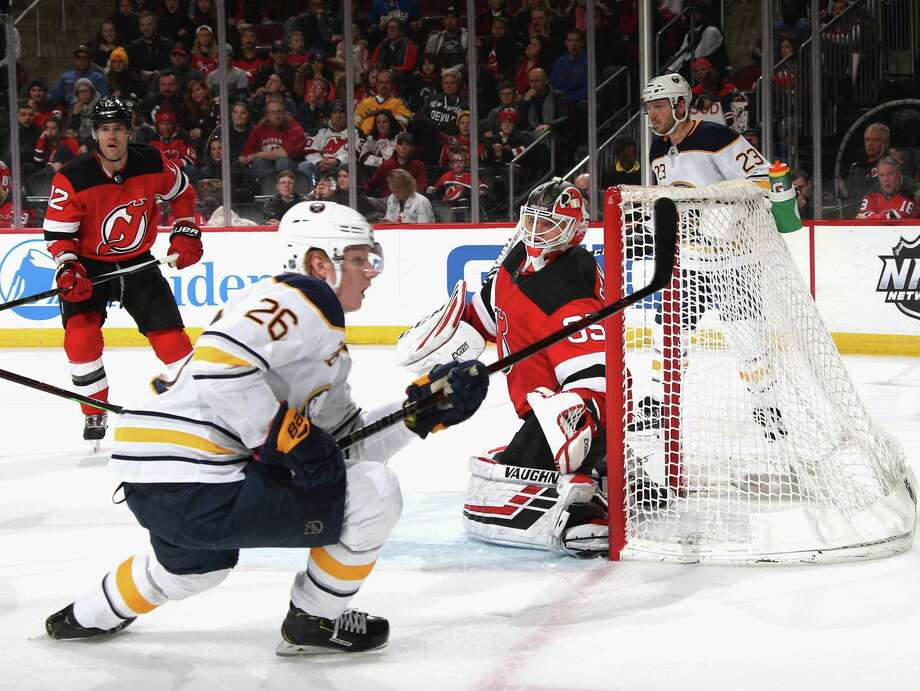 NEWARK, NEW JERSEY - FEBRUARY 17: Cory Schneider #35 of the New Jersey Devils defends the net against Rasmus Dahlin #26 of the Buffalo Sabres during the third period at the Prudential Center on February 17, 2019 in Newark, New Jersey. The Devils defeated the Sabres 4-1. (Photo by Bruce Bennett/Getty Images) Photo: Bruce Bennett / 2019 Getty Images