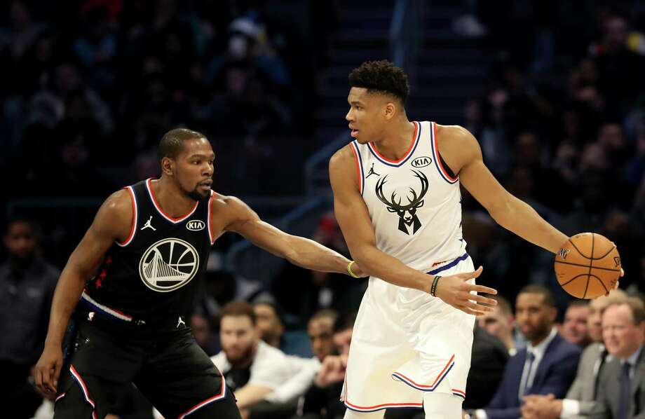 CHARLOTTE, NORTH CAROLINA - FEBRUARY 17: Kevin Durant #35 of the Golden State Warriors and Team LeBron defends Giannis Antetokounmpo #34 of the Milwaukee Bucks and Team Giannis during the NBA All-Star game as part of the 2019 NBA All-Star Weekend at Spectrum Center on February 17, 2019 in Charlotte, North Carolina.  NOTE TO USER: User expressly acknowledges and agrees that, by downloading and/or using this photograph, user is consenting to the terms and conditions of the Getty Images License Agreement. Mandatory Copyright Notice: Copyright 2019 NBAE (Photo by Streeter Lecka/Getty Images) Photo: Streeter Lecka / 2019 Getty Images