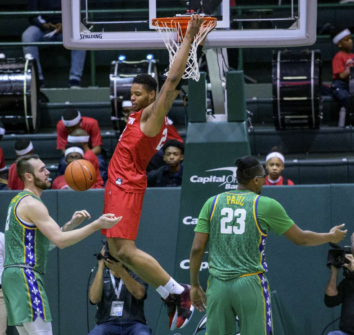 Houston forward Breaon Brady (24) dunks agains Tulane forward Samir Sehic (21) and Tulane forward Blake Paul (23) in the second half of an NCAA college basketball game in New Orleans, Sunday, Feb. 17, 2019. Houston won, 85-50. (AP Photo/Matthew Hinton)