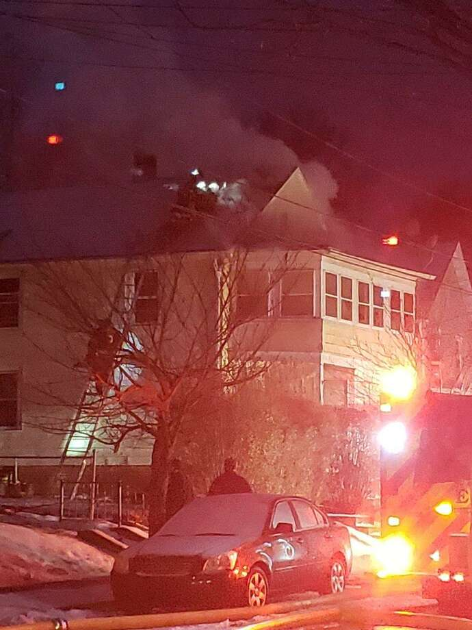 Firefighters fought to contain a fire that broke out at a two-family home in Middletown early Monday morning. Photo: Contributed Photo