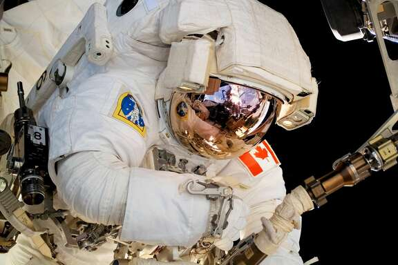 IN SPACE - AUGUST 13:  In this handout photo provided by NASA, Astronaut Dave Williams, STS-118 mission specialist representing the Canadian Space Agency, participates in the mission's second planned session of extravehicular activity (EVA) as construction and maintenance continue on the International Space Station August 13, 2007 in Space. During the 6-hour, 28-minute spacewalk, Williams and astronaut Rick Mastracchio (out of frame), mission specialist, removed a faulty control moment gyroscope (CMG-3) and installed a new CMG into the station's Z1 truss.   (Photo by NASA via Getty Images)