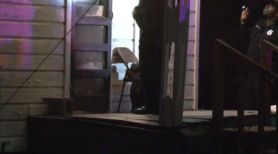 Houston police investigate a shooting late Sunday that left one man dead in the Northside Village subdivision. Police said he was gunned down while sitting on his porch. Photo: Metro Video