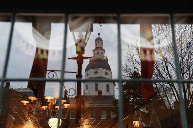 Majorities of Marylanders support progressive proposals pending in the General Assembly, which is in session until April. Shown, the Maryland State House reflected in a window as the Maryland General Assembly convenes the 439th session on Jan. 9, 2019, in Annapolis.