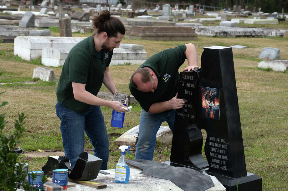 John Scott, left, and Derrick DeYoung of High Cross Monument repair Clarence 'Gatemouth' Browns headstone at Orange's Hollywood Cemetery on Friday. Several large pieces of the iconic bluesmen's marker were broken off during Tropical Storm Harvey.  Photo taken Friday, 2/15/19 Photo: Guiseppe Barranco/The Enterprise / Guiseppe Barranco ©