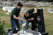 John Scott, left, and Derrick DeYoung of High Cross Monument repair Clarence 'Gatemouth' Browns headstone at Orange's Hollywood Cemetery on Friday. Several large pieces of the iconic bluesmen's marker were broken off during Tropical Storm Harvey. Photo taken Friday, 2/15/19
