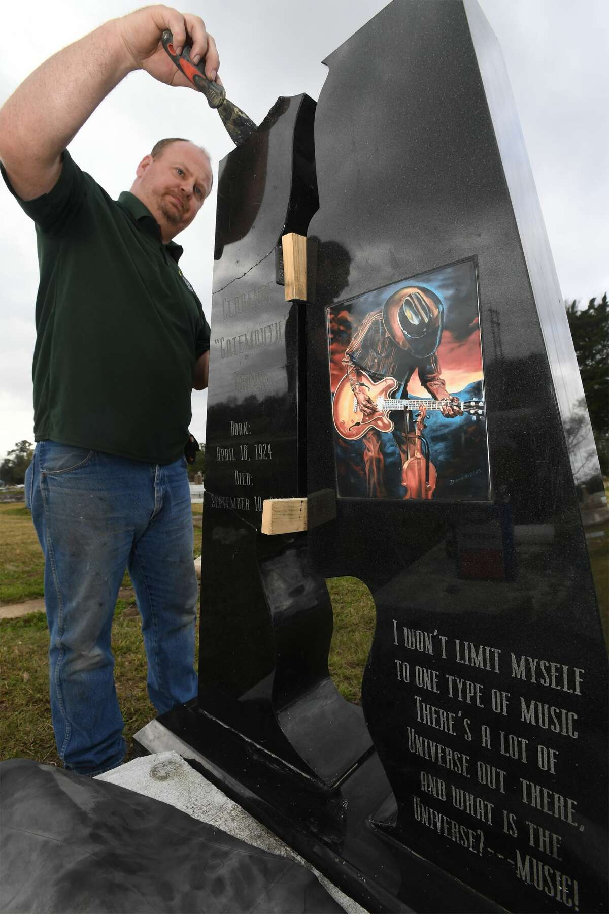 Derrick DeYoung of High Cross Monument repairs Clarence 'Gatemouth' Browns headstone at Orange's Hollywood Cemetery on Friday. Several large pieces of the iconic bluesmen's marker were broken off during Tropical Storm Harvey. Photo taken Friday, 2/15/19