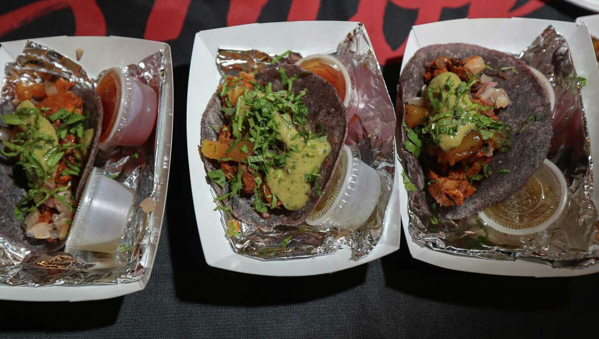 E.J. Miller of International Smoke made pork loin and mezcal-braised pineapple tacos with blue corn tortillas at Cochon555.