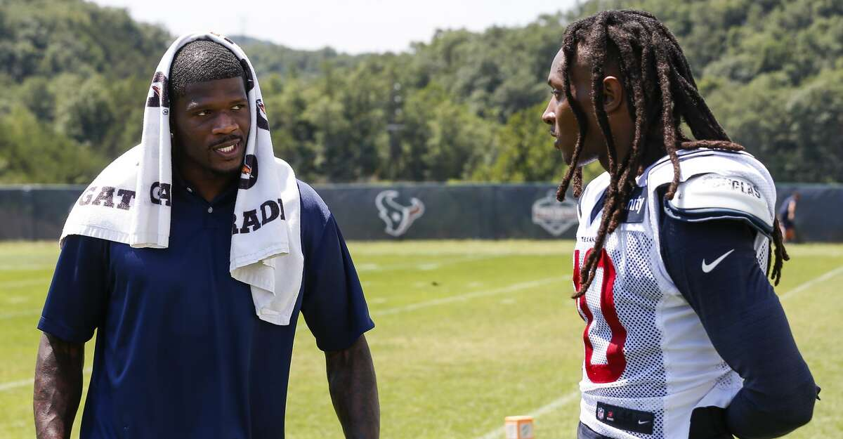 PHOTOS: The 10 best games of Andre Johnson's career Former Houston Texans wide receiver Andre Johnson, left, talks to Texans wide receiver DeAndre Hopkins (10) after practicde during training camp at the Greenbrier Sports Performance Center on Saturday, Aug. 4, 2018, in White Sulphur Springs, W.Va.