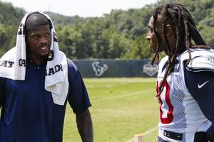 Former Houston Texans wide receiver Andre Johnson, left, talks to Texans wide receiver DeAndre Hopkins (10) after practicde during training camp at the Greenbrier Sports Performance Center on Saturday, Aug. 4, 2018, in White Sulphur Springs, W.Va.