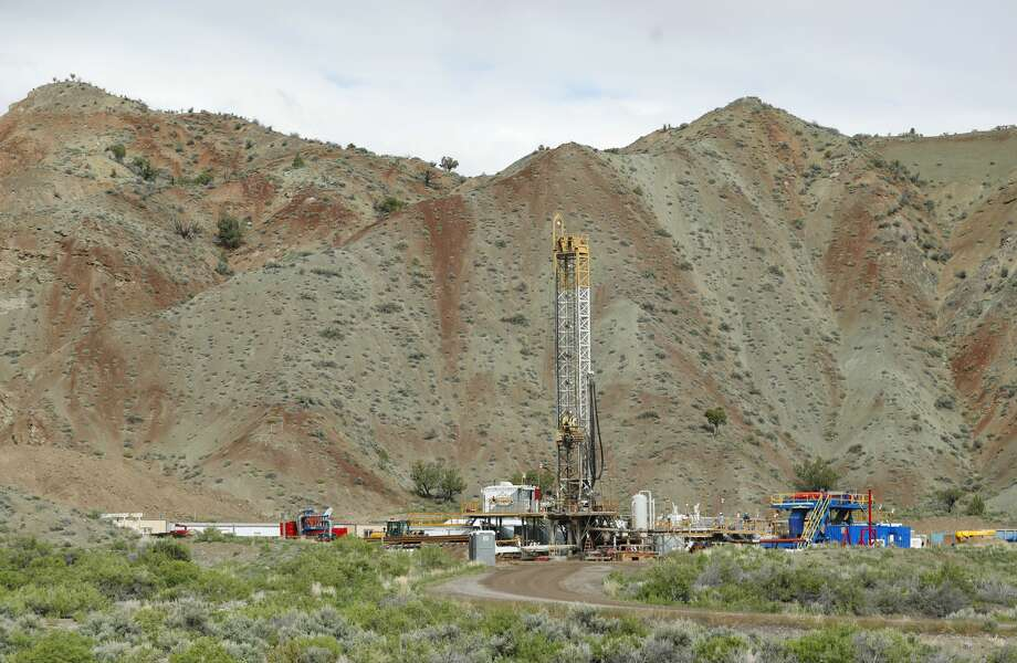 RICHFIELD, UT - MAY 10: An oil drilling rig operates on May 10, 2017 outside Richfield, Utah. Oil and mineral extraction are some of the controversies that are being looked at with the review of the newly created Bears Ears National Monument and the Grand Staircase-Escalante National Monument by the Trump Administration to help determine their future status. (Photo by George Frey/Getty Images) Photo: George Frey/Getty Images
