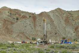 RICHFIELD, UT - MAY 10: An oil drilling rig operates on May 10, 2017 outside Richfield, Utah. Oil and mineral extraction are some of the controversies that are being looked at with the review of the newly created Bears Ears National Monument and the Grand Staircase-Escalante National Monument by the Trump Administration to help determine their future status. (Photo by George Frey/Getty Images)