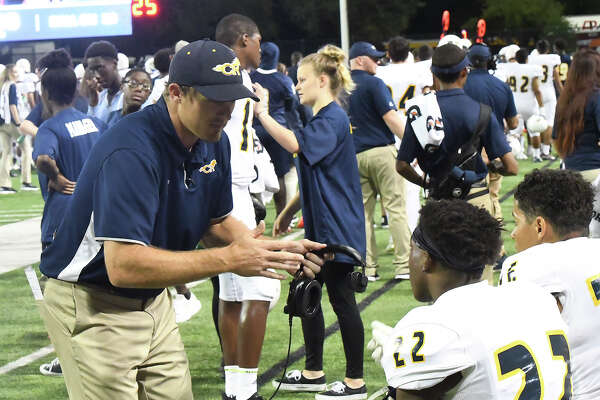 Andrew Shanle (left) has coached and taught at Cypress Ranch High School since 2013, also spending a year with the Mustangs from 2011-2012. The former defensive back played collegiately at the University of Nebraska and won a Super Bowl championship with the New York Giants in 2007.