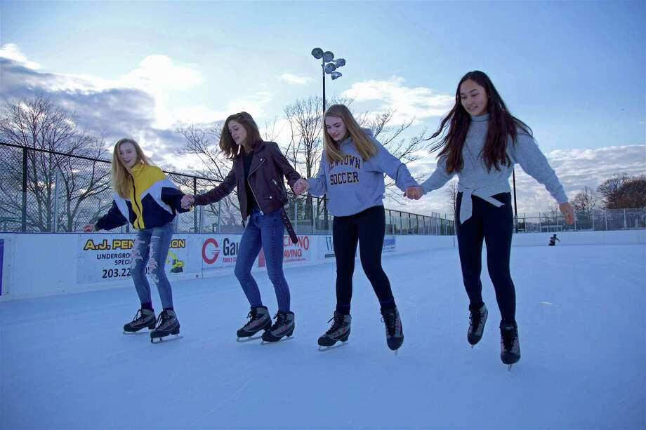 Celebrating their friends birthday with her first attempt at skating are, from left, Aidan Cushing, 16, birthday girl Maddie Fetchick, 16, Sophia Bajcer, 15, and Summer Wilmot, 15, all of Newtown, at the Longshore P.A.L. skating rink on Friday, Feb. 15, 2019, in Westport, Conn. Photo: Jarret Liotta / For Hearst Connecticut Media / Westport News Freelance