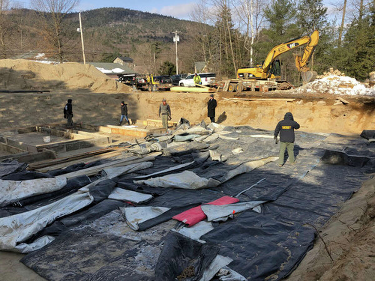 In this Feb. 11, 2019, photo provided by Michael S. Borgos, men stand inside a pit at a construction site in Lake George, N.Y., after skeletal remains were found of people believed to have died during the Revolutionary War. Michael Borgos, attorney for owners Danna and Ruben Ellsworth, said bones from as many as 11 unmarked graves have been found so far in an empty lot.
