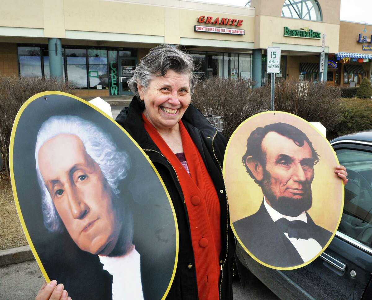 Nancy Bellamy of Clifton Park with portraits of George Washington and Abraham Lincoln that she bought for her grandson Derek Bellamy to show to his kindergarten class for President's Day at Clifton Park Shoppers World plaza Thursday Feb. 16, 2012. (John Carl D'Annibale / Times Union)