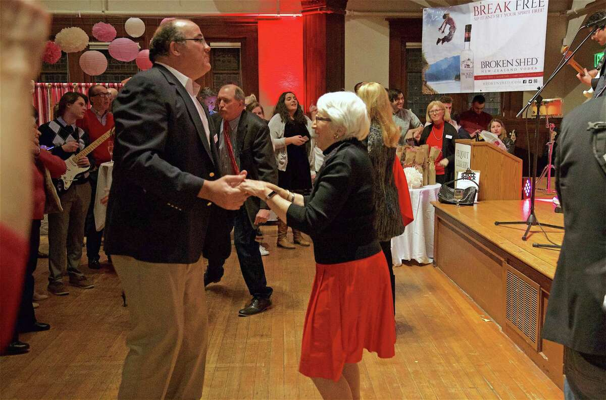 """Thomas Lawlor and Jane Dean of Fairfield share a dance at the Pequot Library's first-ever """"Head over Heels"""" Valentine's Day party on Thursday, Feb. 14, 2019, in Fairfield, Conn."""