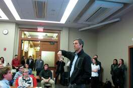 Potential 2020 Democratic presidential candidate Beto O'Rourke stops by an overflow room to thank University of Wisconsin-Madison students who came to hear him speak at an event that attracted more than 200 people on Friday, Feb. 15, 2019, in Madison, Wis. (AP Photo/Scott Bauer)