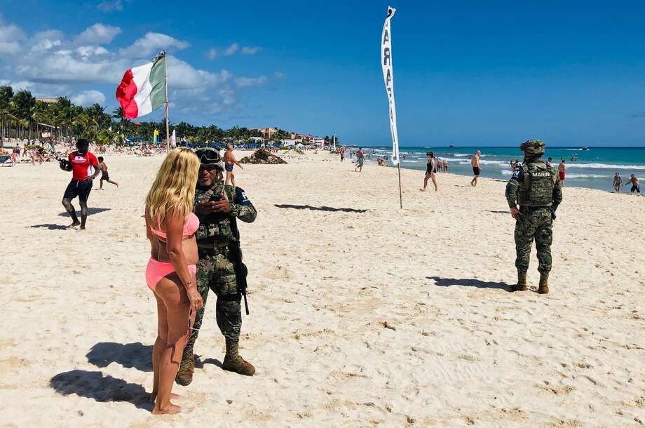 Mexican marines patrol the beach of Playacar, near the seaside tourist resort of Playa del Carmen, Quintana Roo State, on February 14, 2019. - Playa del Carmen and nearby Cancun are the top tourist destinations in Mexico, famous for their turquoise waters and white-sand Caribbean beaches. (Photo by Daniel SLIM / AFP)        (Photo credit should read DANIEL SLIM/AFP/Getty Images) Photo: DANIEL SLIM/AFP/Getty Images