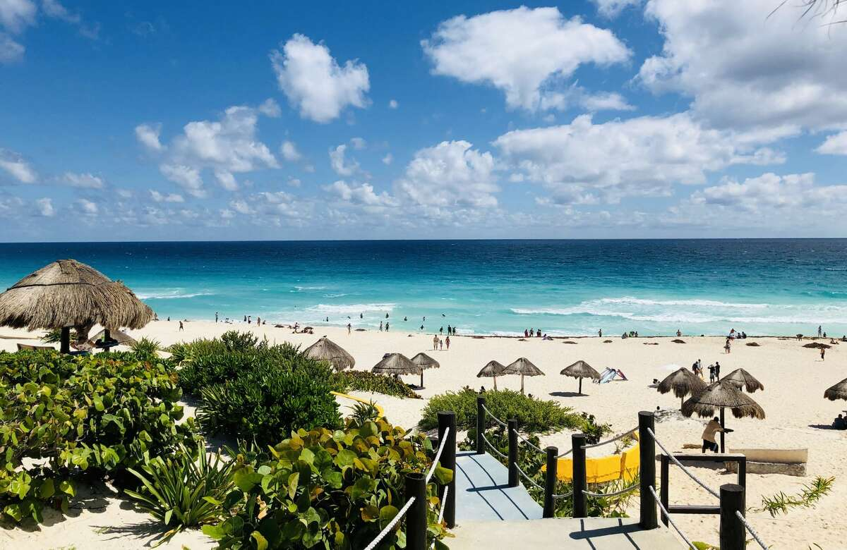 View of the beach as seen from one of the accesses in Cancun, Quintana Roo State, Mexico, on February 16, 2019. - Playa del Carmen and Cancun are the top tourist destinations in Mexico, famous for their turquoise waters and white-sand Caribbean beaches. (Photo by Daniel SLIM / AFP) (Photo credit should read DANIEL SLIM/AFP/Getty Images)