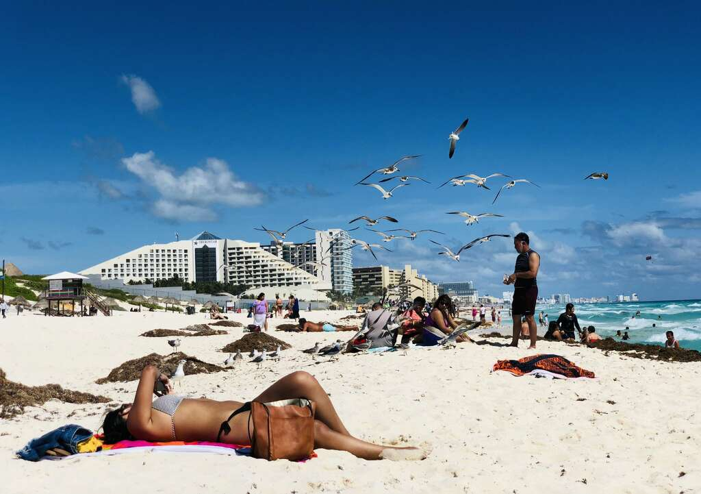 Photos show tourists, Marines on Cancun beaches days before