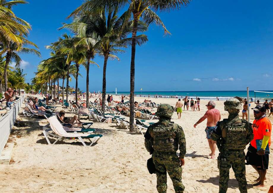 FILE - Mexican marines patrol the beach of Playacar, near the seaside tourist resort of Playa del Carmen, Quintana Roo State, on February 14, 2019. A pair of gunmen burst into a bar and opened fire with pistols, killing one person, in the Mexican resort city on Monday, May 13, 2019. Photo: DANIEL SLIM/AFP/Getty Images