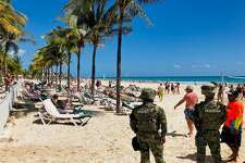 Mexican marines patrol the beach of Playacar, near the seaside tourist resort of Playa del Carmen, Quintana Roo State, on February 14, 2019. - Playa del Carmen and nearby Cancun are the top tourist destinations in Mexico, famous for their turquoise waters and white-sand Caribbean beaches. (Photo by Daniel SLIM / AFP) (Photo credit should read DANIEL SLIM/AFP/Getty Images)