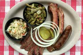 The Classic Trio Plate with brisket, ribs and sausage from Goodfire BBQ