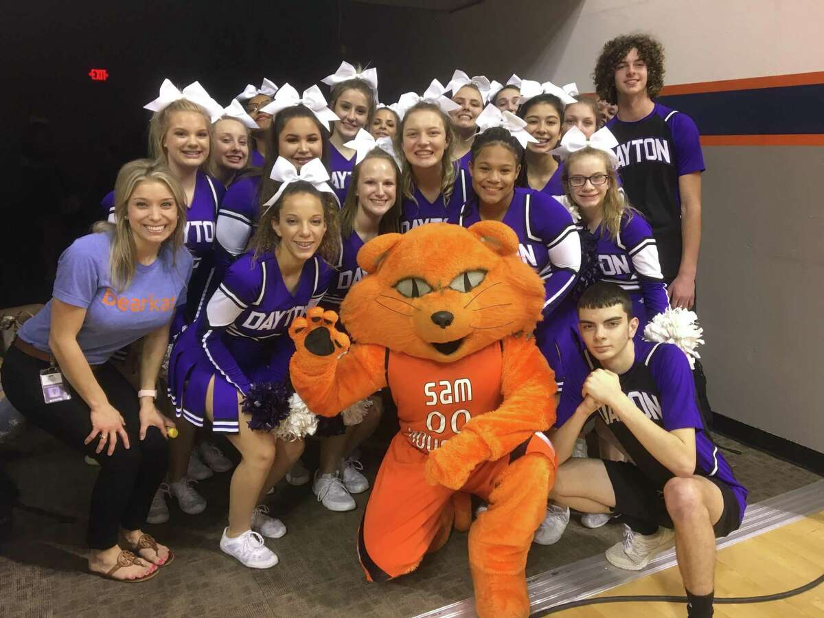 Cheerleaders pose with Sammy Bearkat on the campus of Sam Houston State University. Front row from left, Molly Carter, Emma Rae Thornton, Brooke Alley, Kennedi Mumphrey, K'Lynn Thornton, and Kevin Rasberry. Second row, Coach Morgan Lossow, Lilian Seibert, Skye Ryland, Skylee Green, and Mallory Threadgill. Back row, Kailey Brister, Jaque Brady, Morgan Butler, Kailey Black, Breanna Rogers, and Rilea Trousdale.