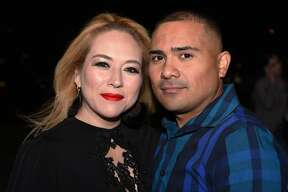 Vanessa Ramon and Julio Estevis pose for a photo during the Banda MS concert.