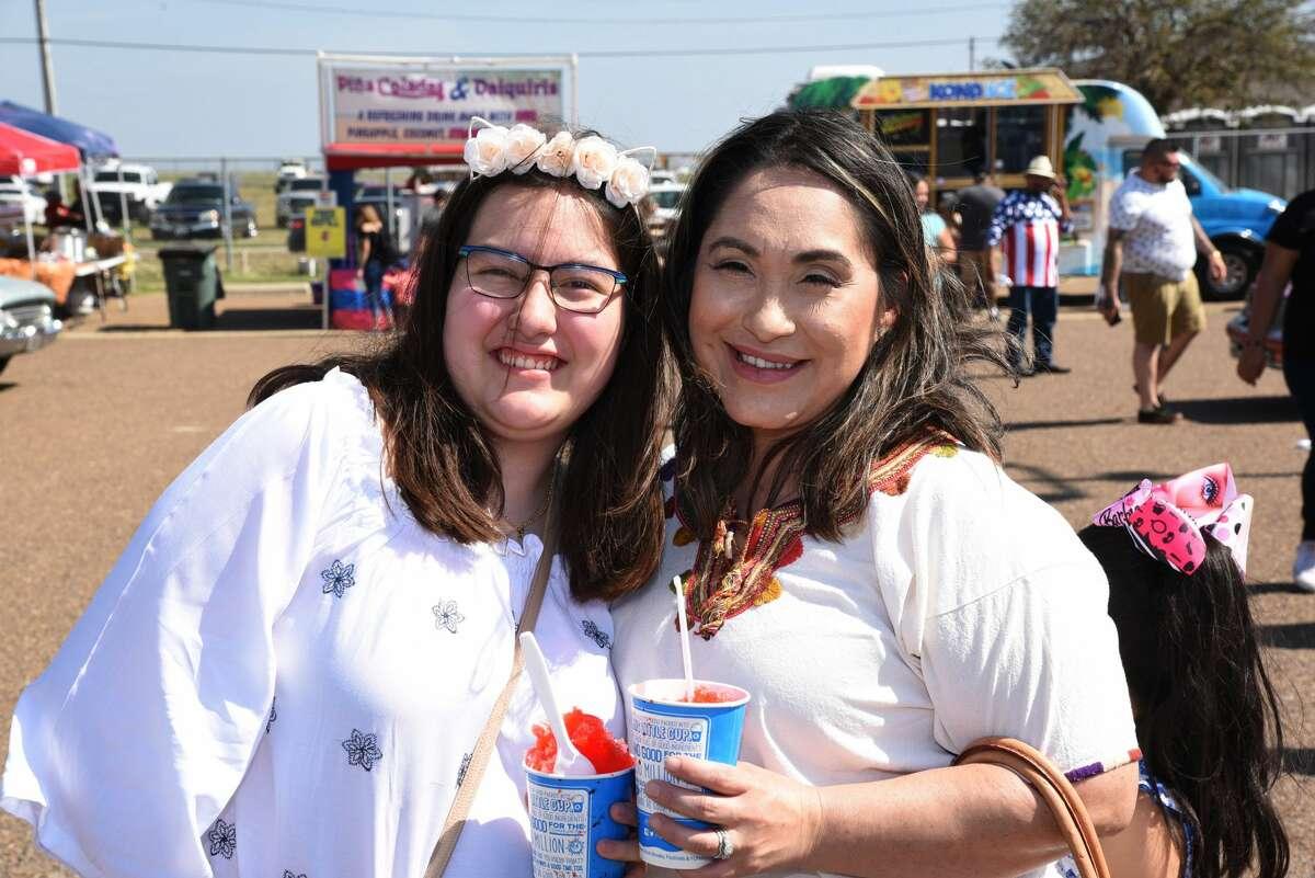 Daniela and Marisa Alvarez pose for a photo during the WBCA Pipes and Stripes Auto Show.