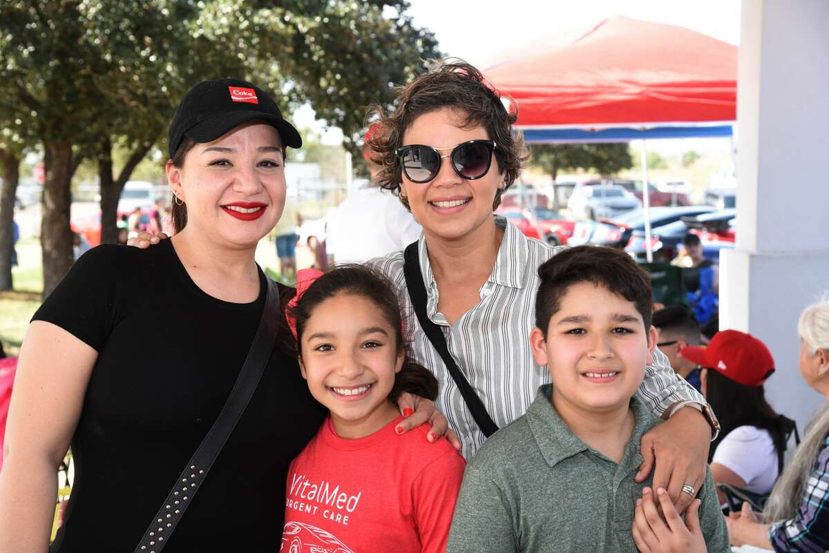 Melina Adame, Mariana, Ana Lucia and Nico Diaz pose for a photo during the WBCA Pipes and Stripes Auto Show.