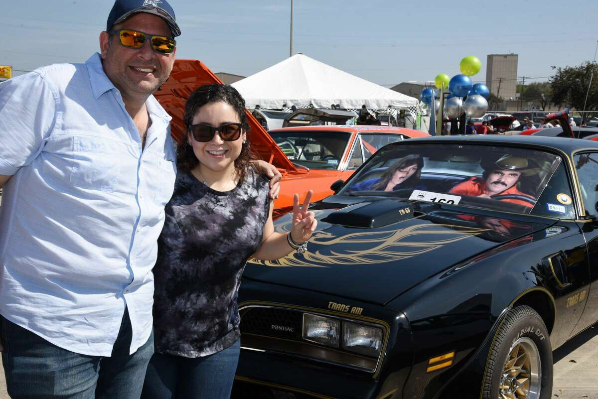 Jose R. Gonzalez and Ceci Diaz pose for a photo during the WBCA Pipes and Stripes Auto Show.