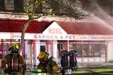 Fire crews were able to save some small animals from inside the feed store. It was immediately unclear if others were trapped inside, according to The Bellingham Herald.
