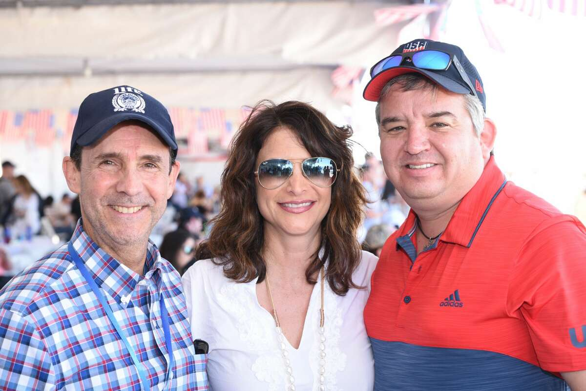 Memo Trevino, Selika and Danny Salinas pose for a photo during the WBCA's Stars and Stripes Air Show.