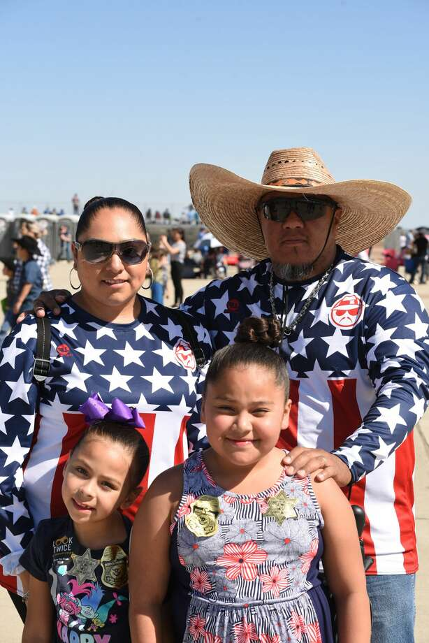 Sylvia Melendez, Felix Melendez, Natalia Melendez and Sophia Montoya pose for a photo during the WBCA's Stars and Stripes Air Show. Photo: Christian Alejandro Ocampo